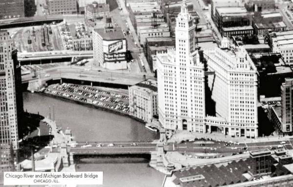 postcard-chicago-chicago-river-and-michigan-blvd-bridge-aerial-looking-w-note-car-park-and-train-yard-1953